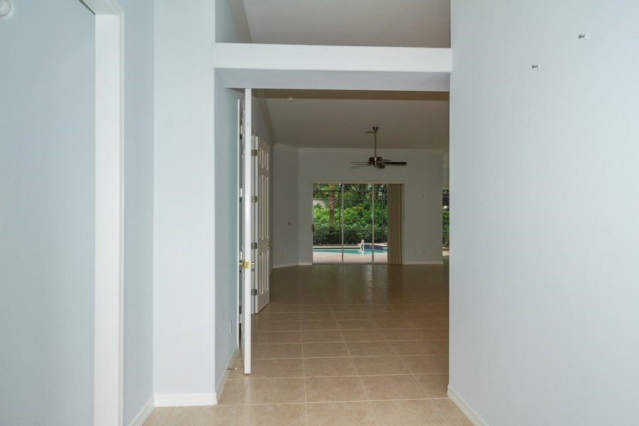Real Estate Photography - 8848 Ventura Way, Naples, FL, 34109 - Hallway