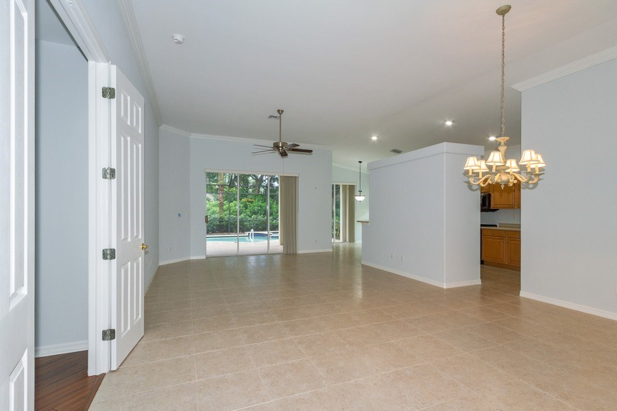 Real Estate Photography - 8848 Ventura Way, Naples, FL, 34109 - Living Room / Dining Room