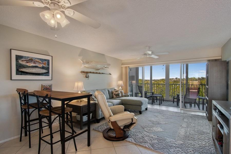 Real Estate Photography - 100 Stevens Landing #206, Marco Island, FL, 34145 - Living Room / Dining Room