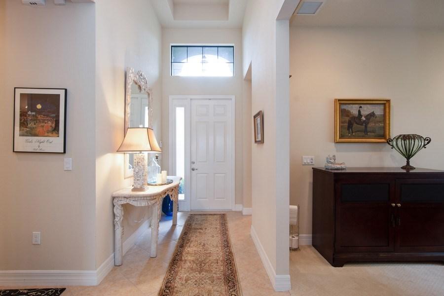Real Estate Photography - 13835 Luna Dr, Marbella Isles, Naples, FL, 34109 - Foyer