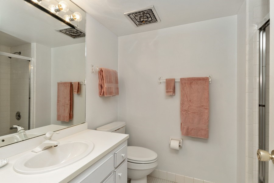 Real Estate Photography - 1910 Gulf Shore Blvd N, 106, Naples, FL, 34102 - Master Bathroom