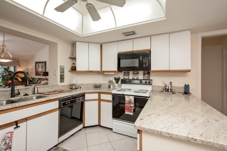 Real Estate Photography - 4250 Lake Forest Dr, 323, Bonita Springs, FL, 34134 - Kitchen