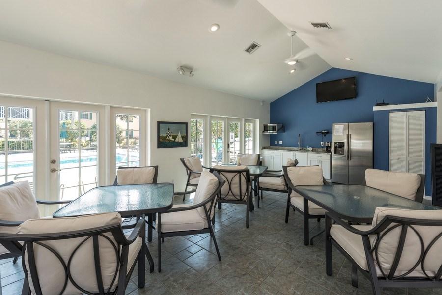 Real Estate Photography - 7096 Barrington circle #202, Naples, FL, 34108 - Clubhouse