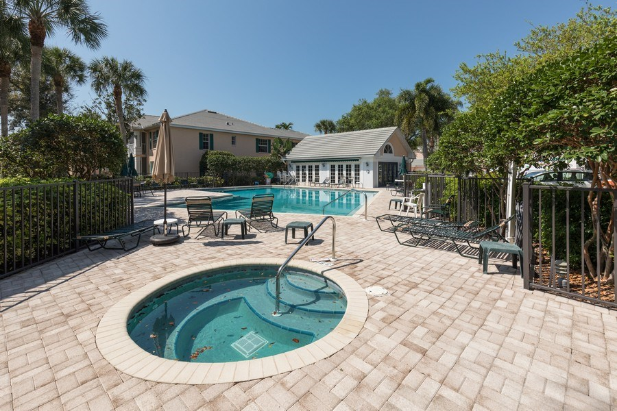 Real Estate Photography - 7096 Barrington circle #202, Naples, FL, 34108 - Community Pool and Clubhouse