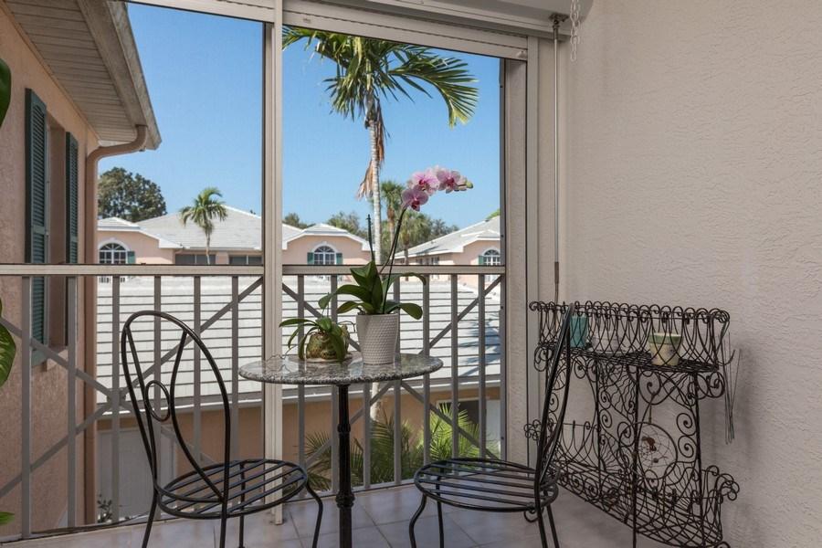 Real Estate Photography - 7096 Barrington circle #202, Naples, FL, 34108 - Front Balcony