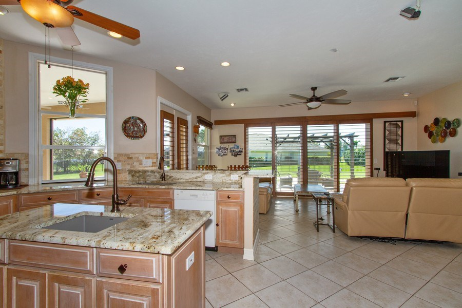 Real Estate Photography - 2118 Imperial Cir, Naples, FL, 34110 - Family Room / Kitchen