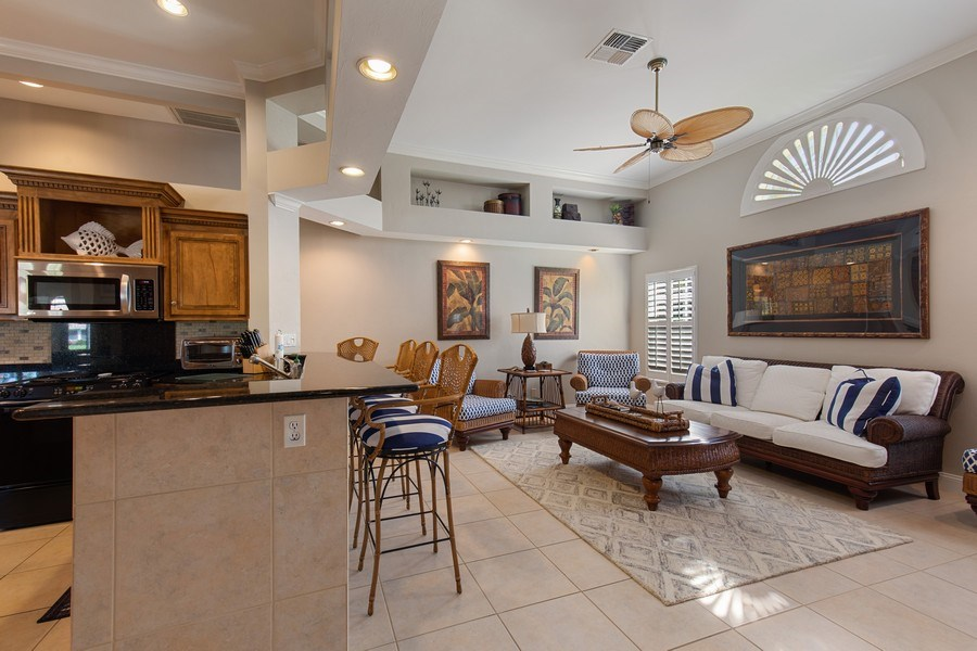 Real Estate Photography - 28841 Trenton Ct, Bonita Springs, FL, 34134 - Family Room / Kitchen