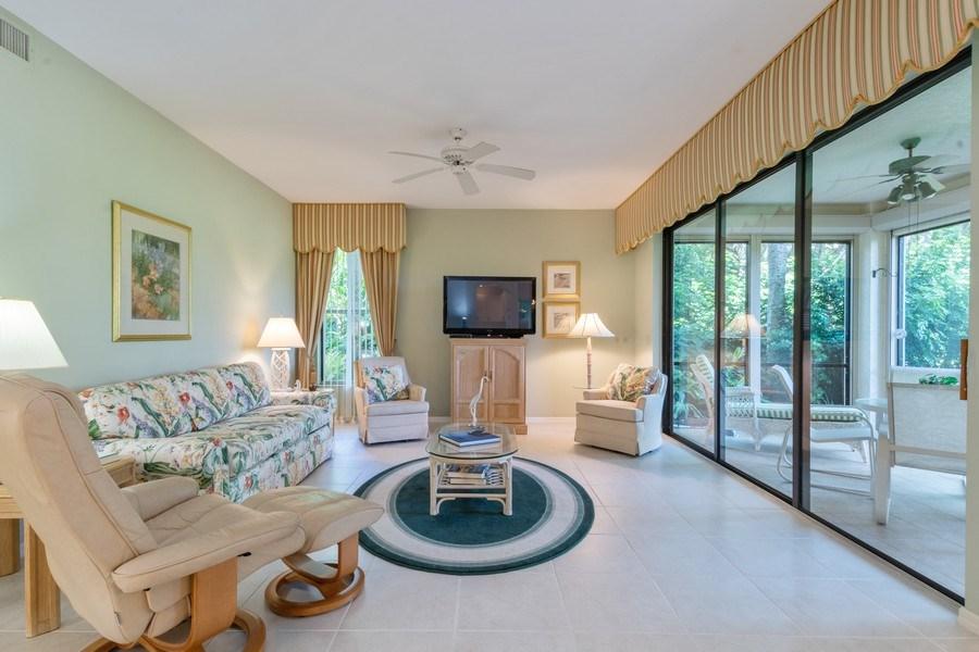 Real Estate Photography - 7048 Pelican Bay Blvd. C-105, Naples, FL, 34108 - Living Room