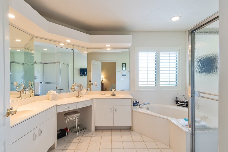 Real Estate Photography - 7048 Pelican Bay Blvd. C-105, Naples, FL, 34108 - Master Bathroom