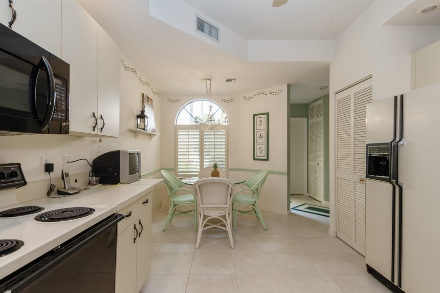 Real Estate Photography - 7048 Pelican Bay Blvd. C-105, Naples, FL, 34108 - Kitchen