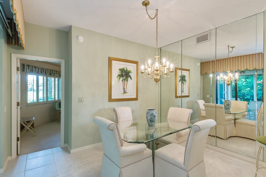 Real Estate Photography - 7048 Pelican Bay Blvd. C-105, Naples, FL, 34108 - Dining Area