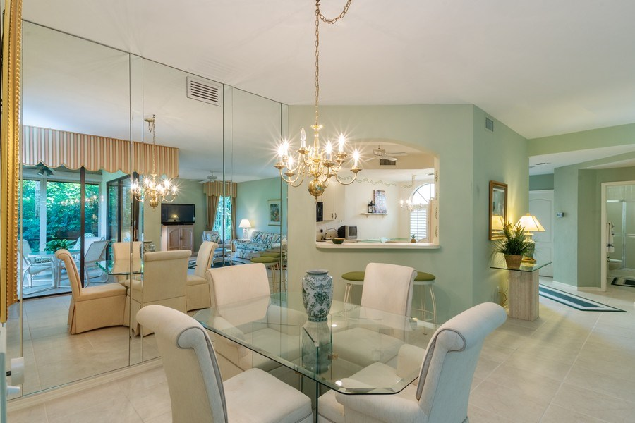 Real Estate Photography - 7048 Pelican Bay Blvd. C-105, Naples, FL, 34108 - Dining Area 2