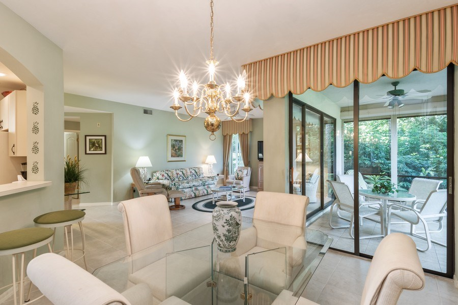 Real Estate Photography - 7048 Pelican Bay Blvd. C-105, Naples, FL, 34108 - Living Room / Dining Room