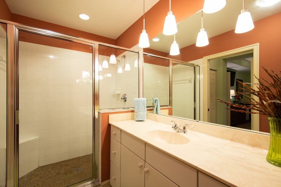 Real Estate Photography - 20800 Hammock Greens Ln, Unit 105, Estero, FL, 33928 - Master Bathroom