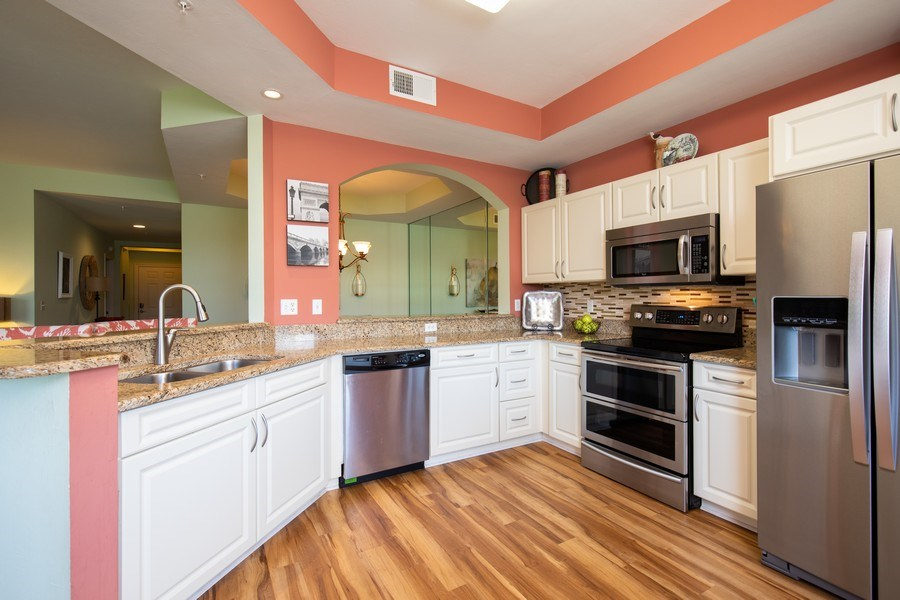 Real Estate Photography - 20800 Hammock Greens Ln, Unit 105, Estero, FL, 33928 - Kitchen