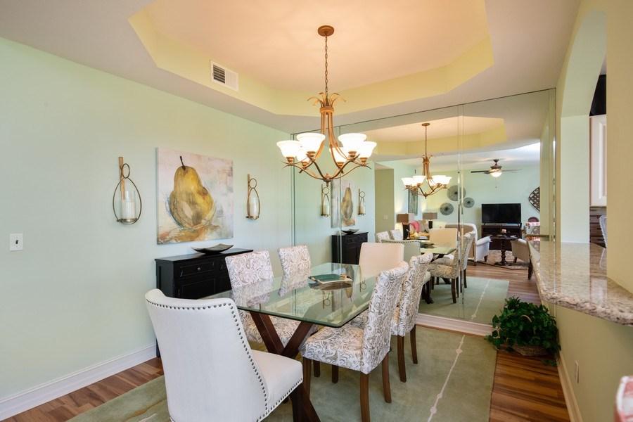 Real Estate Photography - 20800 Hammock Greens Ln, Unit 105, Estero, FL, 33928 - Dining Room