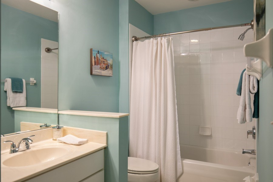 Real Estate Photography - 20800 Hammock Greens Ln, Unit 105, Estero, FL, 33928 - 2nd Bathroom