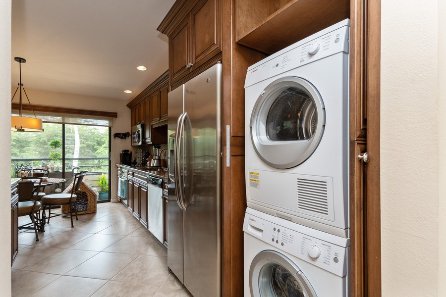 Real Estate Photography - 929 8th Ave S, Naples, FL, 34102 - Laundry area /custom built in cabinet