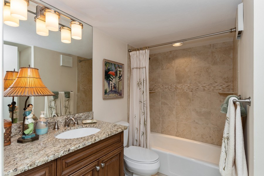 Real Estate Photography - 929 8th Ave S, Naples, FL, 34102 - Guest bathroom