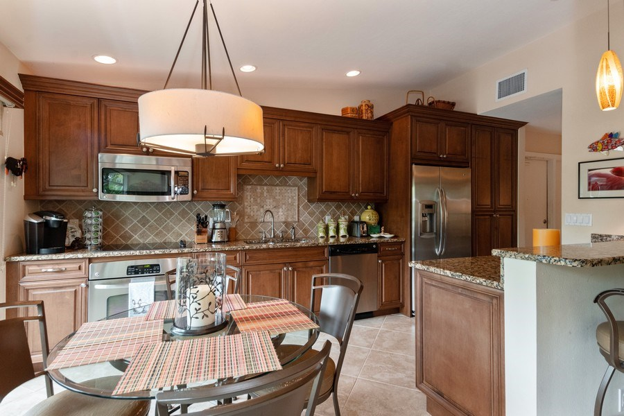 Real Estate Photography - 929 8th Ave S, Naples, FL, 34102 - Kitchen / Dining Room