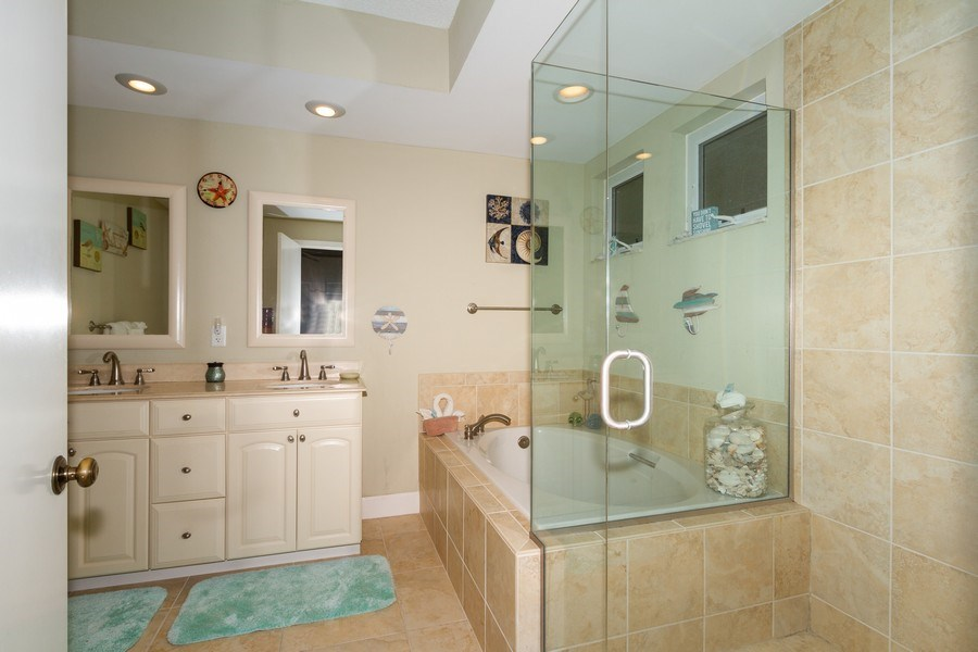Real Estate Photography - 5805 Glencove Dr #704, Naples, FL, 34108 - Master Bathroom