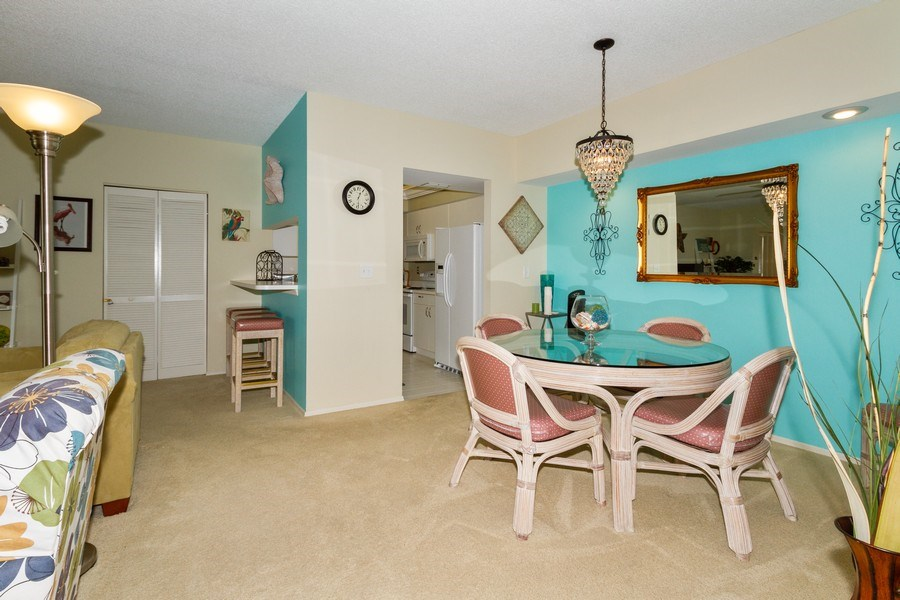 Real Estate Photography - 5805 Glencove Dr #704, Naples, FL, 34108 - Dining Room
