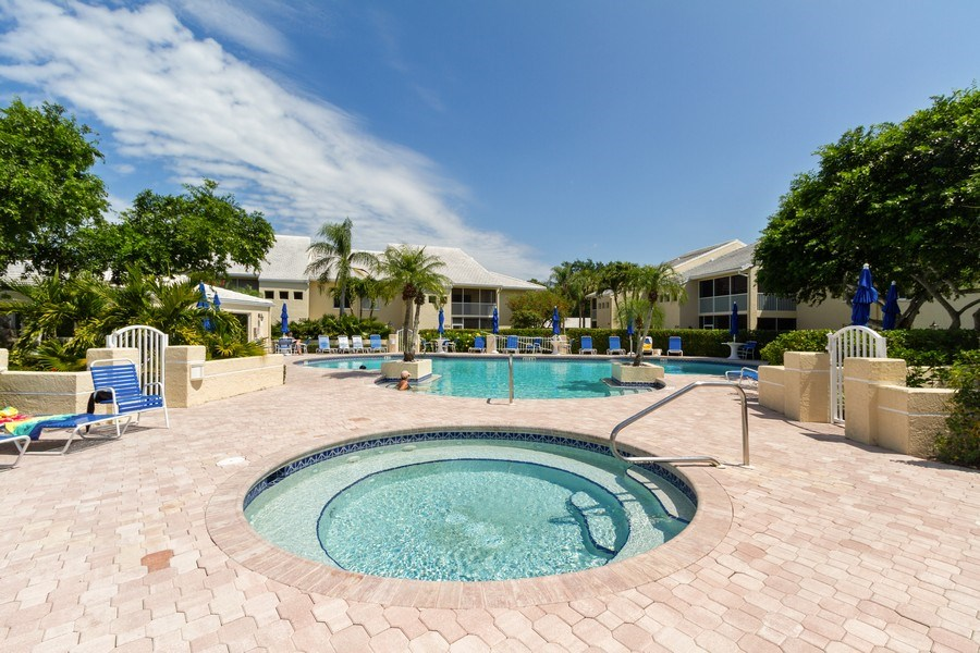 Real Estate Photography - 5805 Glencove Dr #704, Naples, FL, 34108 - Outdoor Pool