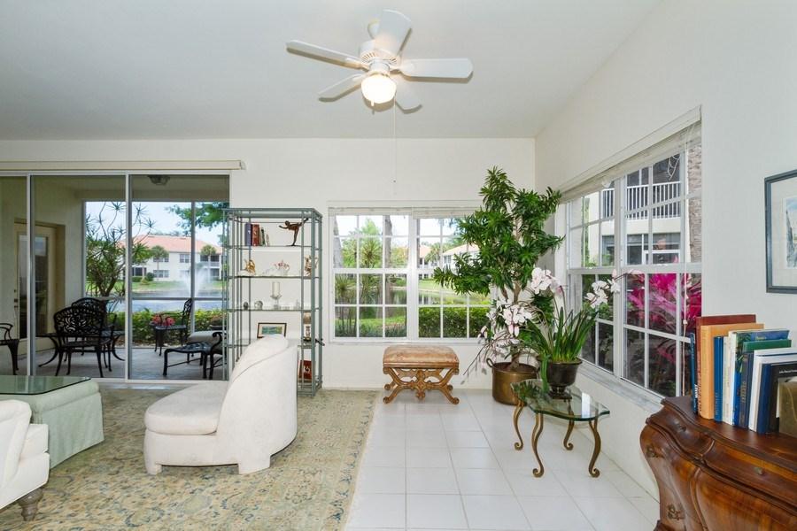 Real Estate Photography - 1036 Egrets Walk Circle #104, Naples, FL, 34108 - Living Room / Dining Room