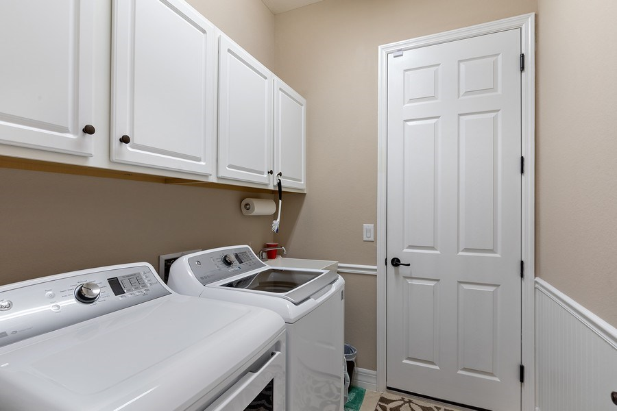 Real Estate Photography - 17571 Monaghan Run, Bonita Springs, FL, 34135 - Laundry Room