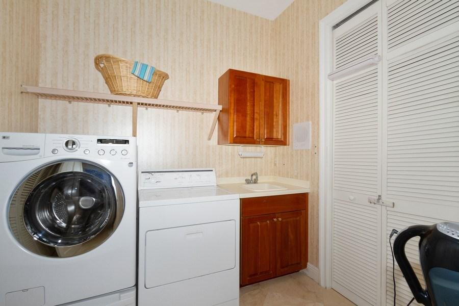 Real Estate Photography - 615 Via Mezner, Unit 1703, Naples, FL, 34108 - Laundry Room