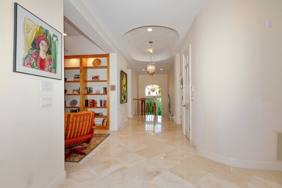 Real Estate Photography - 615 Via Mezner, Unit 1703, Naples, FL, 34108 - Hallway