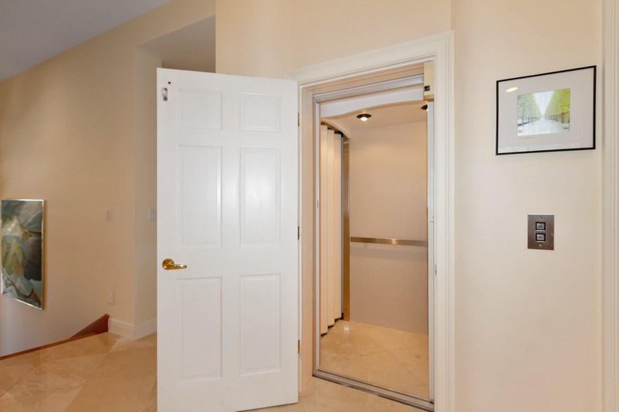 Real Estate Photography - 615 Via Mezner, Unit 1703, Naples, FL, 34108 - Elevator