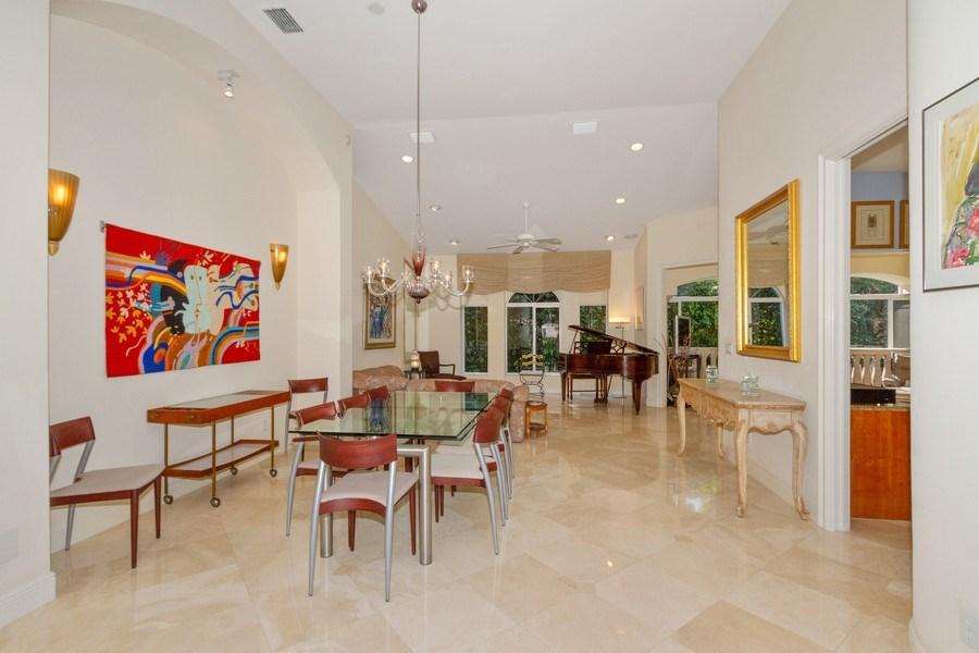 Real Estate Photography - 615 Via Mezner, Unit 1703, Naples, FL, 34108 - Living Room / Dining Room