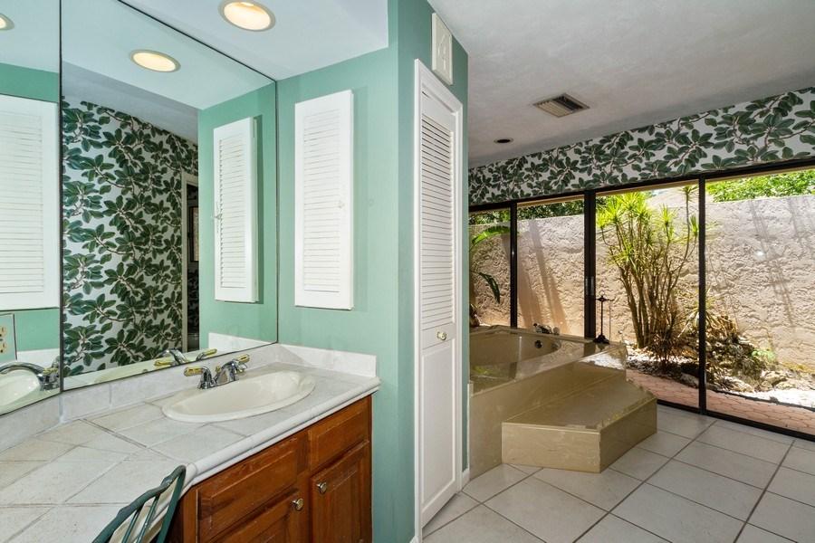 Real Estate Photography - 570 Bald Eagle Drive, Naples, FL, 34105 - Master Bathroom