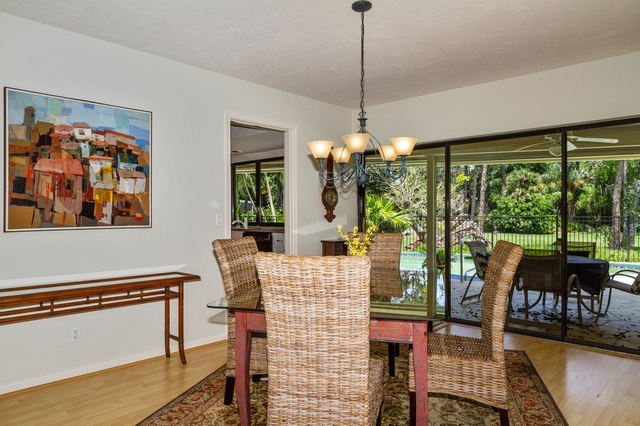 Real Estate Photography - 570 Bald Eagle Drive, Naples, FL, 34105 - Dining Room