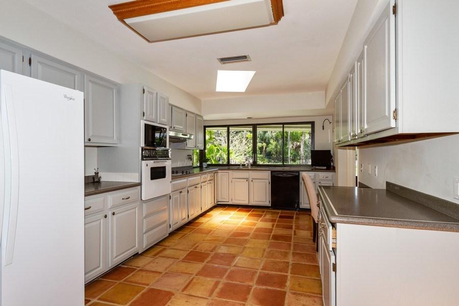 Real Estate Photography - 570 Bald Eagle Drive, Naples, FL, 34105 - Kitchen