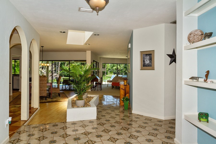 Real Estate Photography - 570 Bald Eagle Drive, Naples, FL, 34105 - Hallway