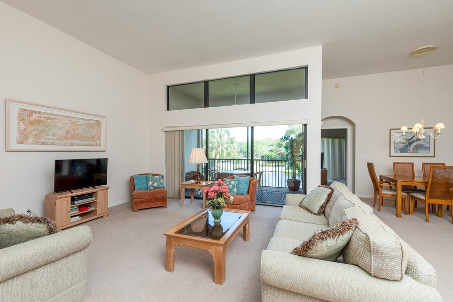 Real Estate Photography - 7000 Pelican Day Blvd, Unit A203, Naples, FL, 34108 - Living Room