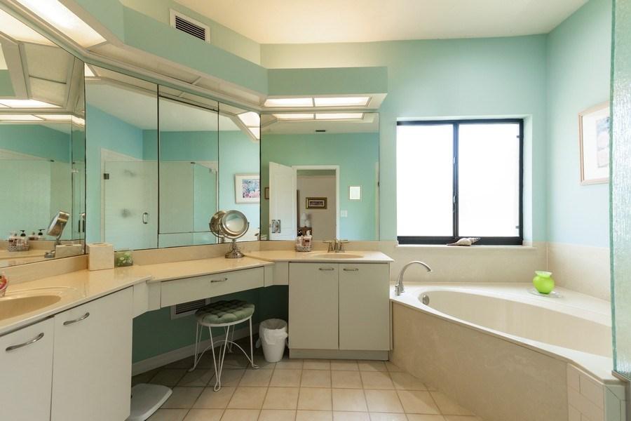 Real Estate Photography - 7000 Pelican Day Blvd, Unit A203, Naples, FL, 34108 - Master Bathroom