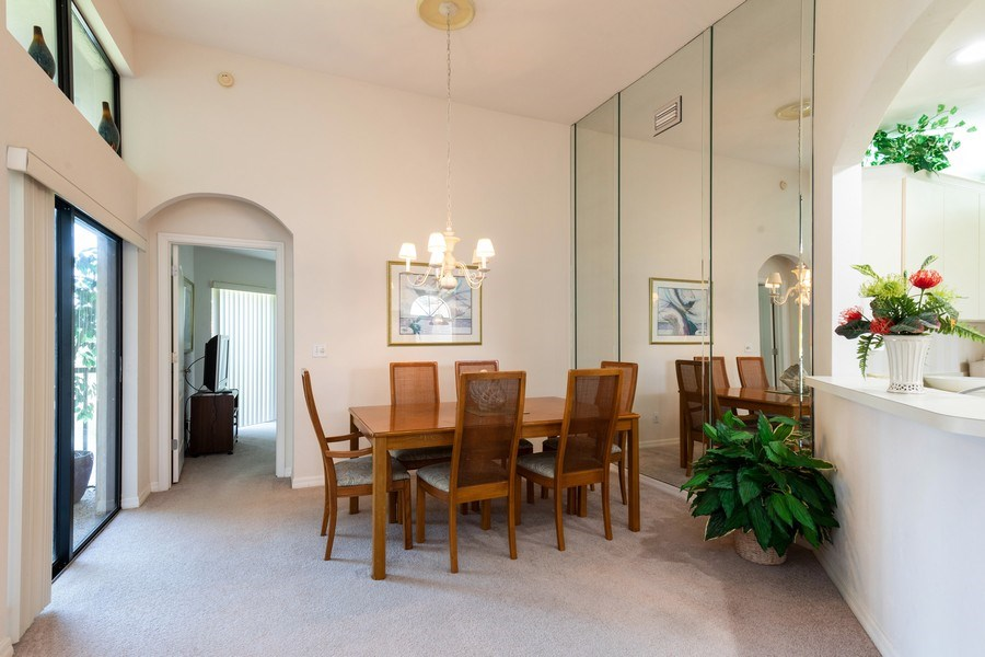 Real Estate Photography - 7000 Pelican Day Blvd, Unit A203, Naples, FL, 34108 - Dining Room