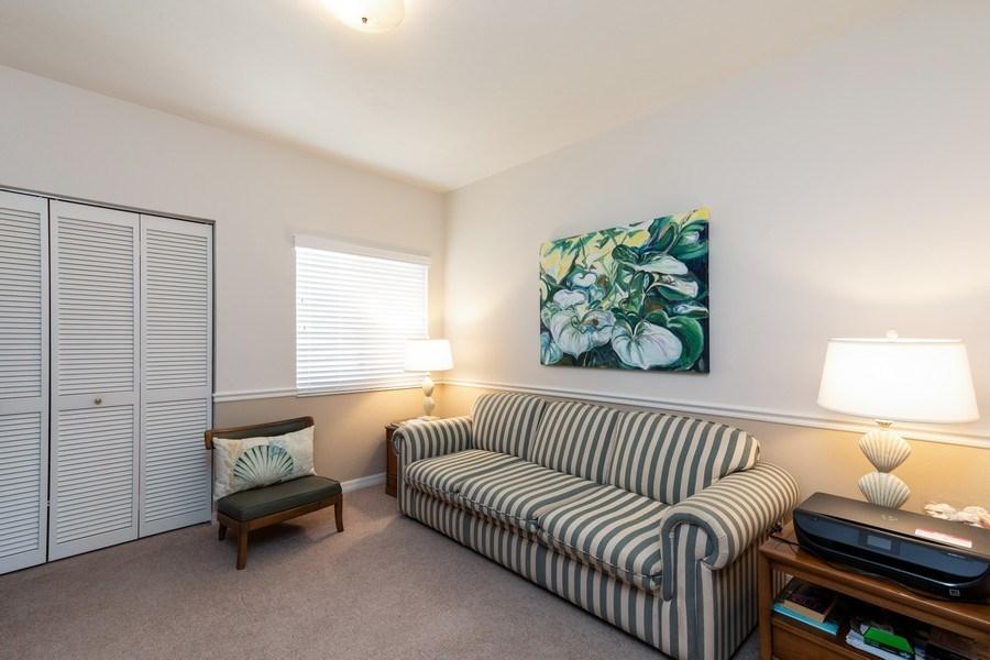 Real Estate Photography - 7000 Pelican Day Blvd, Unit A203, Naples, FL, 34108 - Den