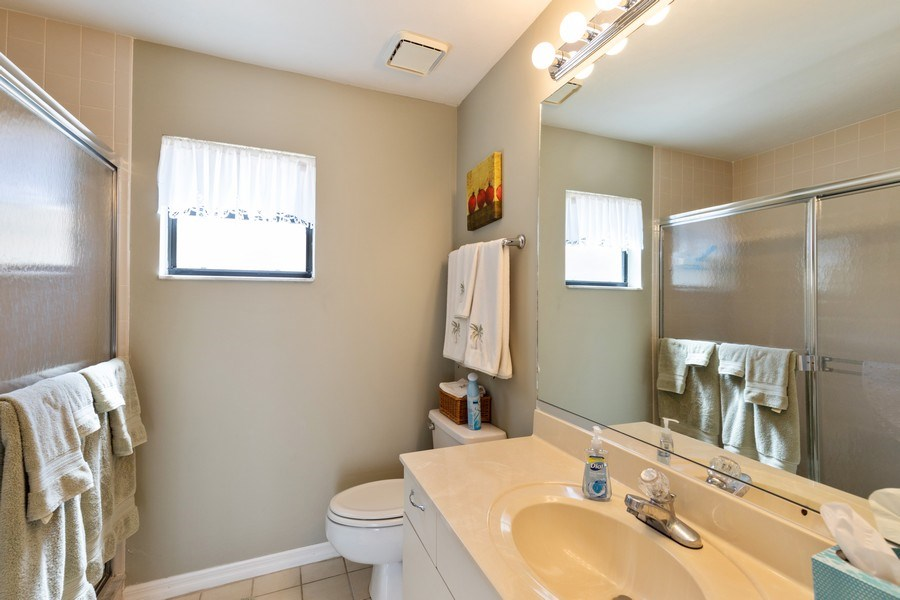 Real Estate Photography - 7000 Pelican Day Blvd, Unit A203, Naples, FL, 34108 - 2nd Bathroom