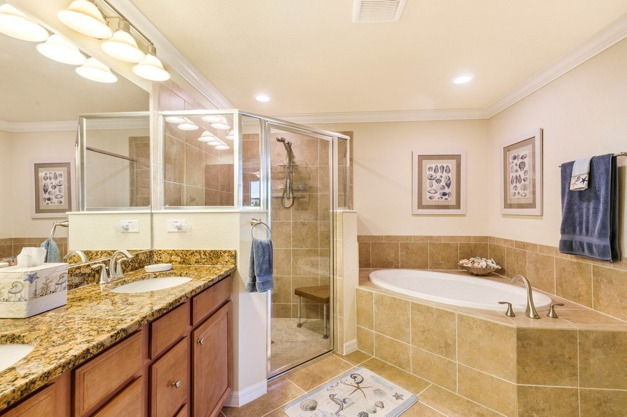 Real Estate Photography - 28100 Cookstown Court, Unit 2204, Bonita Springs, FL, 34135 - Master Bathroom