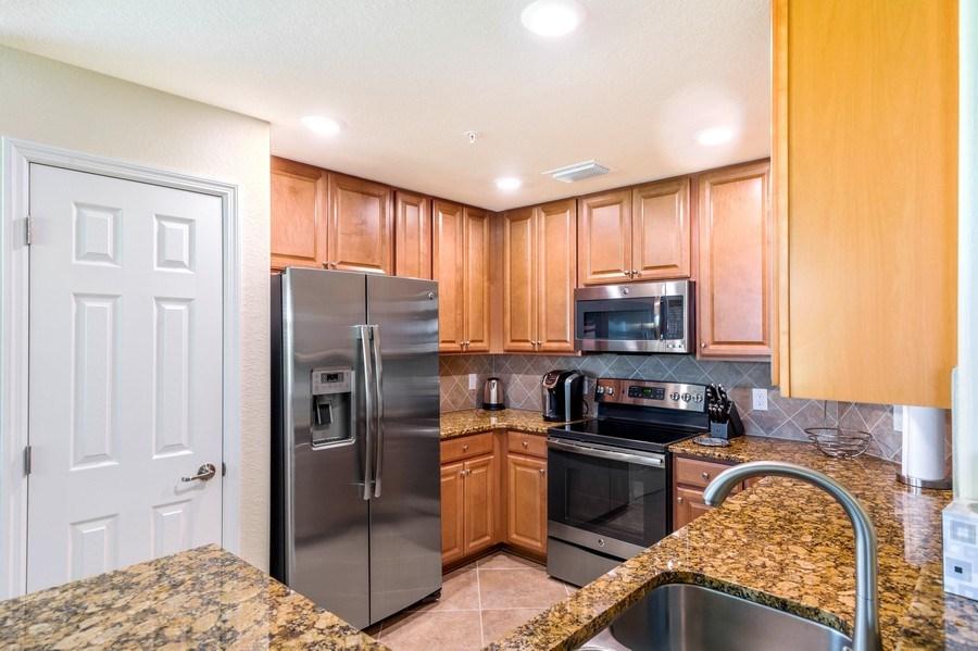 Real Estate Photography - 28100 Cookstown Court, Unit 2204, Bonita Springs, FL, 34135 - Kitchen
