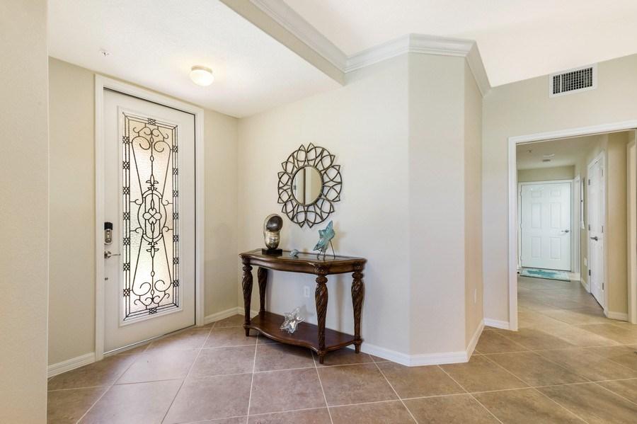 Real Estate Photography - 28100 Cookstown Court, Unit 2204, Bonita Springs, FL, 34135 - Foyer
