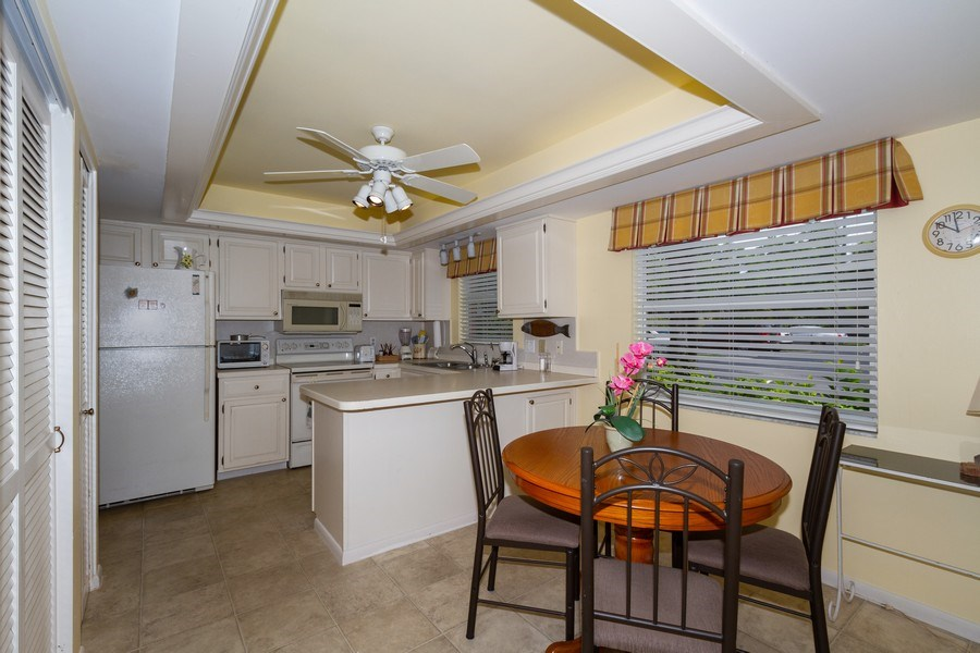 Real Estate Photography - 3200 Binnacle Drive F-2, Naples, FL, 34103 - Kitchen / Breakfast Room