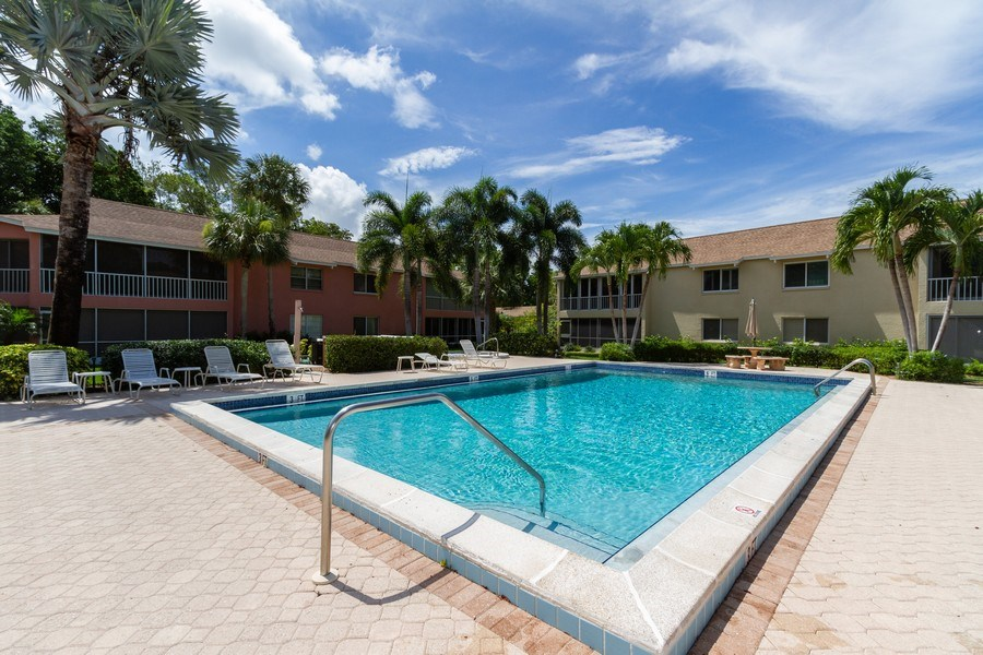 Real Estate Photography - 3200 Binnacle Drive F-2, Naples, FL, 34103 - Outdoor Pool