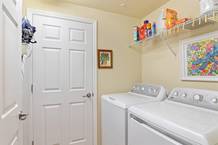 Real Estate Photography - 28550 Carlow Ct 504, Bonita Springs, FL, 34135 - Laundry Room