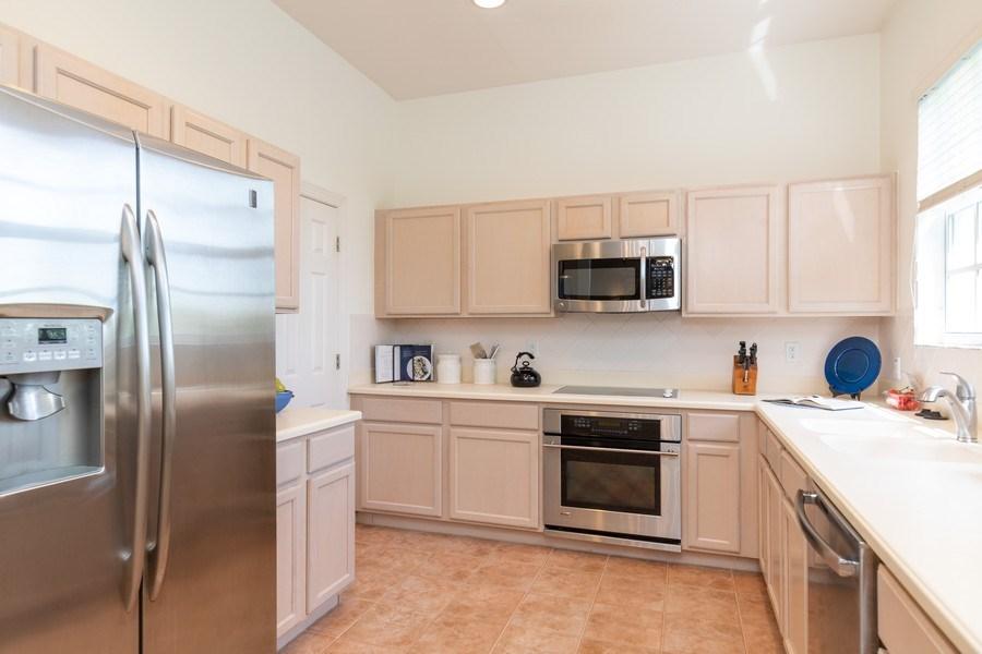 Real Estate Photography - 26916 Wyndhurst Ct. #201, Bonita Springs, FL, 34134 - Kitchen