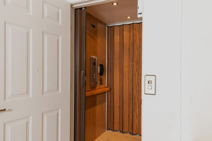 Real Estate Photography - 26916 Wyndhurst Ct. #201, Bonita Springs, FL, 34134 - Elevator